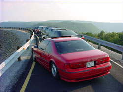 Super Coupe Club of the Southeast SC Rock City III event, their 3rd annual Chattanooga meet, in August 2003.  This picture was taken on the dam atop Racoon Mountain. The cars in the picture belong to (starting from the closest):